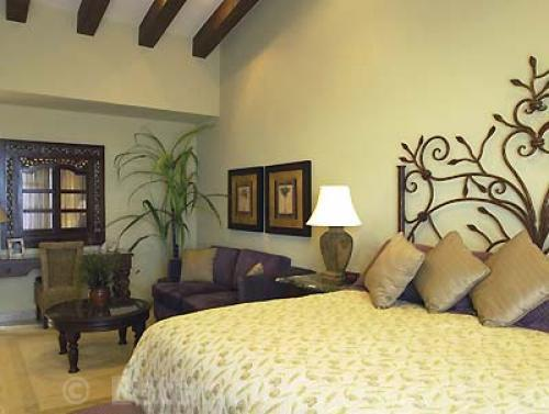 king bed with artisan designed headboard.