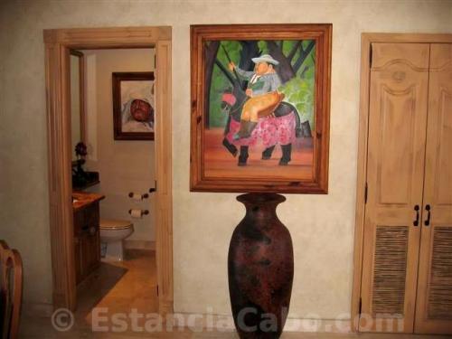 artisan wall art and an artisan vase as part to the decor in villa 1402