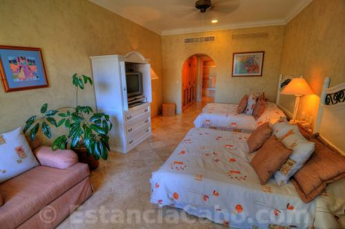 The second bedroom features 2 queen beds and a private bathroom.