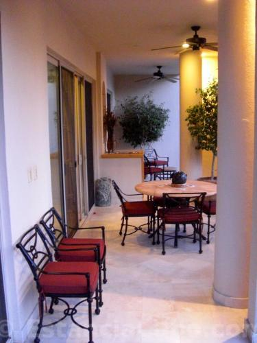 veranda in villa 1302.  the veranda is equiped with a wet bar and plenty of outdoor seating.