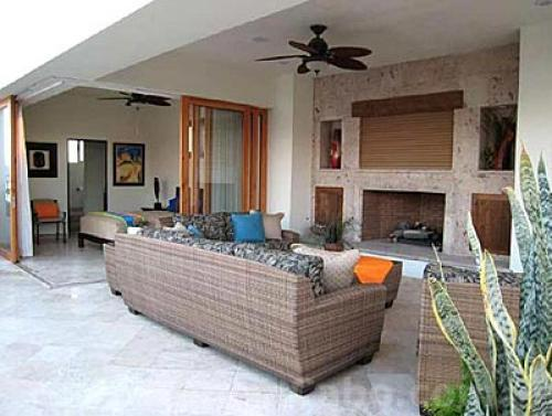 Seating area in front of the outdoor fireplace of the Penthouse 3806 of Villa La Estancia Cabo.