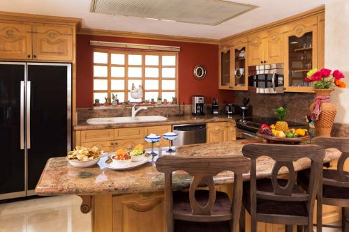 The Proffesional Gourmet Kitchen is fully equiped with top of the line stainless steel appliances.  The Kitchen also has granite countertops.