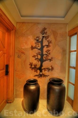 Villa entryway with decorative stone wall