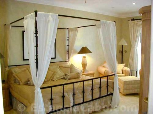 Master bedroom with king size canopy bed.